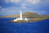 Uk, Scotland, Inner Hebrides, Isle of Mull. a Lighthouse Guards the Entrance to the Island. Photographic Print by Ken Scicluna