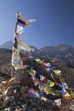 Nepal, Mustang. Prayer Flags Fluttering at Dajori La Pass, High Up Above the Village of Samar. Photographic Print by Katie Garrod