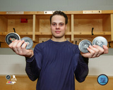 Auston Matthews holding the 4 pucks after he scored four goals in his first NHL Game 10/12/16 Photo