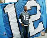 Ken Griffey Jr. with the 12th man flag at Centurylink Field in Seattle Photo