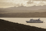 A Passenger Expedition Ship Cruises the Galapagos Islands Photographic Print by Jad Davenport
