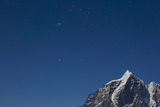 Himalayan Mountain Range Against Blue Sky with Stars at Night in the Khumbu Region Photographic Print by John Burcham
