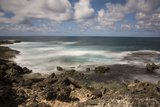 View of the Indian Ocean and Rocky Shore of a Tiny Offshore Island Photographic Print by Gabby Salazar