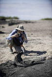 Tourist Photographing a Marine Iguana on Fernandina Island Photographic Print by Jad Davenport