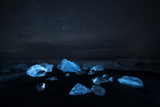 Glacier Ice Illuminated on Black Sand Beach in Jokulsarlon, Iceland Photographic Print by Chad Copeland
