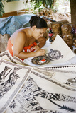 An Artist Works on Traditional Tapa Drawings Photographic Print by Dmitri Alexander
