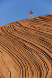 A Woman Hiking on Snow Canyon State Park, Utah Photographic Print by John Burcham