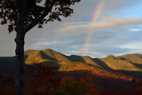 A Rainbow in the Sky at Dawn as Seen from the Hancock Overlook on the Kancamagus Highway Photographic Print by Darlyne Murawski