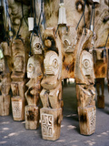 Fierce Tikis Support an Artisan's Drums in the Marquesas Islands Fotografisk tryk af Dmitri Alexander