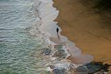 A Man Walks on a Beach Along the Napali Coast on Kauai, Hawaii Photographic Print by Karen Kasmauski