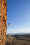 A Male Rock Climber Rappelling in Snow Canyon State Park Photographic Print by John Burcham
