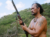 A Hunter Searches for Goats in the Marquesas Islands Fotografisk tryk af Dmitri Alexander