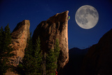 A Climber Ascends a Rock Formation under a Full Moon Near Lily Lake in Estes Park Photographic Print by Keith Ladzinski