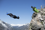 Wingsuit Pilots Exit Leap from a Cliff Ledge Photographic Print by Chad Copeland