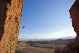 A Man Rappelling on the Red Rock Cliffs of Saint George, Utah Photographic Print by John Burcham