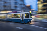 A Blurred Motion View of a Tram at Night in Zurich, Switzerland Photographic Print by Greg Dale