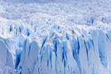 Deep Blue Cracks on the Front Wall of the Perito Moreno Glacier Photographic Print by Mike Theiss