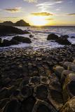 Giant's Causeway Lies at the Foot of Basalt Cliffs on the Edge of the Antrim Plateau Lámina fotográfica por Jonathan Irish