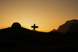Silhouette of a Surfer Leaving Camp to Find Waves on Beach Photographic Print by Chad Copeland