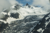 Clouds Clear over Peaks and a Glacier in the Alaska Range Photographic Print by Beth Wald