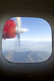 View of the Himalayan Mountains and Moving Airplane Propeller Seen Through Window Photographic Print by John Burcham