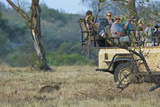 Tourists Encounter a Leopard in South Africa's Sabi Sand Game Reserve Photographic Print by Steve Winter