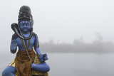 Lord Shiva Statue on the Ganga Talao Lake or Grand Bassin, a Sacred Hindu Site Photographic Print by Gabby Salazar