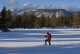 A Man Snowshoeing in Front of San Francisco Peaks in Flagstaff, Arizona Photographic Print by John Burcham