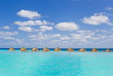 A Resort Swimming Pool and Caribbean Sea in Cancun, Mexico Photographic Print by Mike Theiss