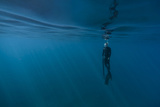 Diver Surfacing from the Deep Blue Ocean Off the Island of Maui Photographic Print by Chad Copeland