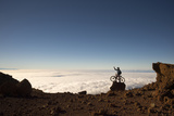 Mountain Biker Above the Clouds in Haleakala National Park Photographic Print by Chad Copeland
