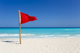 A Red Flag Is Posted as a Warning of Caution on the Beaches of Cancun, Mexico Photographic Print by Mike Theiss