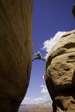 A Man Climbing a Sandstone Tower in Sedona, Arizona Photographic Print by John Burcham