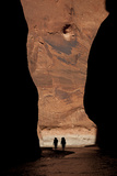 Silhouette of Two Hikers in Paria Canyon, Arizona Photographic Print by John Burcham