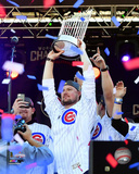 Jon Lester holds World Series Championship Trophy at victory parade 11/4/16, Grant Park in Chicago Photo