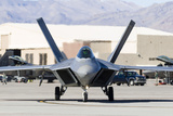 A U.S. Air Force F-22A Raptor Taxiing at Nellis Air Force Base, Nevada Photographic Print by  Stocktrek Images