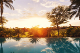 Beautiful Luxury Home with Swimming Pool at Sunset Photographic Print by Epicstock Media