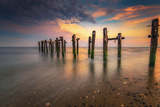 Colorful Scene of Wood Pilings at Walnut Beach in Stratford Connecticut at Beach Shore at Sunset Photographic Print by Elena Paraskeva