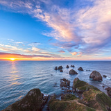 Rocks and Sea Stacks at Nugget Point, Otago, New Zealand Photographic Print by  Travellinglight