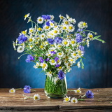 Bouquet of Chamomiles and Cornflowers in the Vase on the Wooden Table Photographic Print by Valentyn Volkov