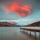 A Spectacular Lenticular Cloud, Lit by Rays of Rising Sun Fotografisk trykk av  Travellinglight
