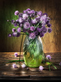 Bouquet of Onion Flowers in the Vase on the Wooden Table Photographic Print by Valentyn Volkov