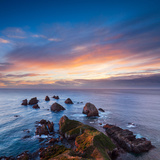 Rocks and Sea Stacks at Nugget Point Otago New Zealand, Sunrise Photographic Print by  Travellinglight