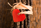 Wood Red Heart Attached with Twine to Wrapped Twigs Set on Rustic Wood Photographic Print by Jeff Wasserman