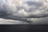 Tornado Touching Down at Sea with Dark Clouds Swirling Photographic Print by R. Gino Santa Maria