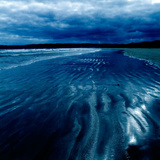Ripples in the Sand on a Beach Photographic Print by Tim Kahane