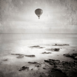 A Hot Air Balloon Floating Above the Sea Photographic Print by  Trigger Image