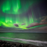 Northern Lights over the Waves Breakiing on the Beach in Seltjarnarnes, Reykjavik, Iceland Photographic Print by Ragnar Th Sigurdsson