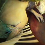 Close Up of Young Woman Resting on the Piano with Bare Back and Summer Dress Photographic Print by Tim Kahane