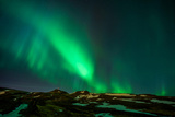Northern Lights or Aurora Borealis over Mt. Ulfarsfell, Close to Reykjavik, Iceland Photographic Print by  Arctic-Images